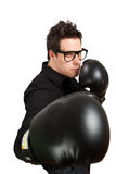 Boxing geek. Guy in glasses wearing boxing gloves. Isolated on white stock images