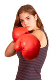 Boxing girl. Healthy young woman in red boxing gloves stands on the ready, her guard up at a cardio boxing workout Stock Photos