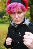 Boxing Girl. Young woman with coloured red hair defending herself Stock Image