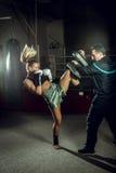 Boxing girl doing knee kick Royalty Free Stock Image