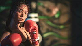 A boxing girl on the stage. At Thailand stock image