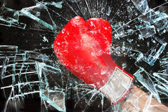 Boxing through glass window. Royalty Free Stock Photography