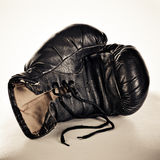 Boxing glove. On a brown background Royalty Free Stock Image