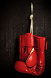 Boxing-glove. Hanging on grunge background Stock Images