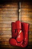 Boxing-glove. Hanging on grunge background Royalty Free Stock Photography