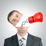 Boxing glove beating from businessmans head. On grey background Stock Image