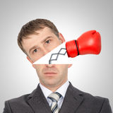 Boxing glove beating from businessmans head. On grey background, closeup Royalty Free Stock Photography