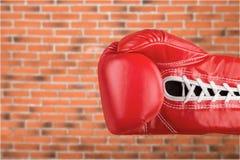 Boxing glove. Punching black sports glove aggression assail ambuscade Royalty Free Stock Photos