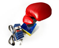 Boxing glove coming out of a gift box. Fake present for joke. Royalty Free Stock Photos