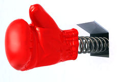 Boxing glove coming out from a hole Royalty Free Stock Images