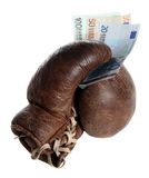 Boxing glove with european banknotes Royalty Free Stock Photos