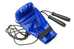 Boxing glove and skipping rope Stock Photo