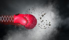 Boxing glove surprise. Mixed media. Boxing glove on spring on dark sky background. Mixed media Stock Images
