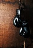 Boxing-glove on wooden background. Boxing-glove hanging on wooden background Stock Images
