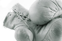 Boxing gloves. Old and white boxing gloves royalty free stock image