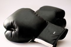 Boxing-gloves. Close-up picture of black and white boxing-gloves with white background stock photo