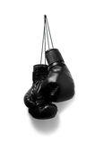 Boxing gloves. Image of black boxing gloves hanging on the wall Stock Photo