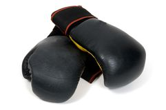 Boxing gloves. A pair of black boxing gloves shot against a white background Royalty Free Stock Photos