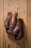 Boxing Gloves. Hanging against an old wood wall stock images