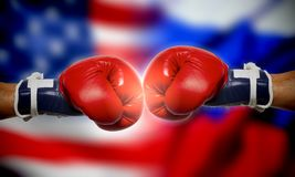 Boxing gloves on the background of Russian and American flags Stock Photos