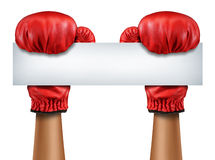 Boxing Gloves Blank Sign. As a fight and competition communication message with isolated red boxer equipment holding a horizontal blank white card as a business Stock Photo