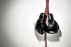 Boxing gloves. Hanging with red protective cloth on white wall at boxing camp stock photography