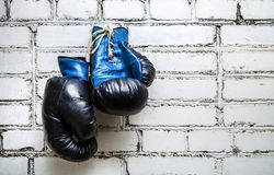 Boxing gloves on brick wall Stock Images