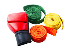 Boxing gloves and collection of belts isolated on white background Stock Photos