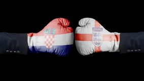 Boxing gloves with Croatia and Three Lions Soccer England National Football Team flag. Croatia versus UK concept. On black stock photography