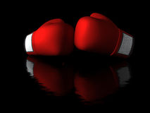 Boxing gloves in dark background Royalty Free Stock Images