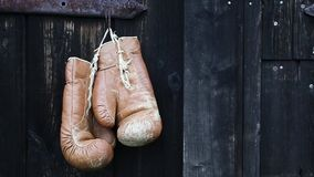 Boxing gloves and diving mask hanging on old wooden door. stock footage