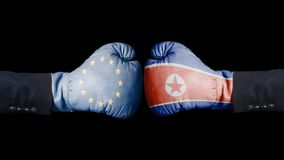 Boxing gloves with European Union and North Korean flag. European Union versus North Korea concept. Isolated On Black Background royalty free stock photo