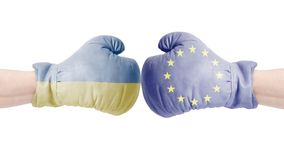 Boxing gloves with European Union and Ukraine flag.European Union vs Ukraine concept. Isolated on a white background Royalty Free Stock Images