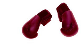 Boxing gloves falling on the floor Stock Photography