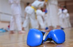 Boxing gloves on floor of sport hall Stock Images