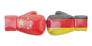 Boxing gloves with Germany and China flags. Governments conflict. Concept, 3D Stock Photo