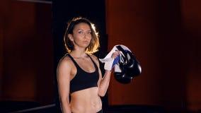 Boxing gloves in the girl`s hands. Portrait. 4K. Boxing gloves in the girl`s hands. Portrait stock footage