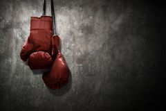 Boxing gloves hanging on the wall. Boxing gloves hang on the wall stock images