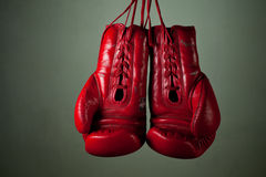 Boxing gloves hanging from laces