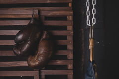 Boxing gloves hanging. On wooden wall Royalty Free Stock Images