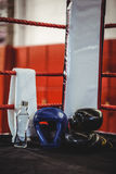Boxing gloves, headgear, water bottle and a towel in boxing ring Stock Images