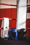 Boxing gloves, headgear, water bottle and a towel in boxing ring Stock Photography