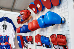 Boxing gloves, helmets and shoes for martial arts in shop. Boxing gloves, helmets and shoes for martial arts in a sports shop Stock Image