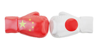 Boxing gloves with Japan and China flags. Governments conflict c. Oncept Royalty Free Stock Photos