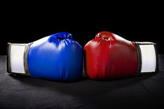Boxing Gloves. Or martial arts gear on a black background Stock Image