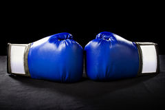 Boxing Gloves. Or martial arts gear on a black background Royalty Free Stock Image