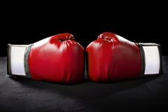 Boxing Gloves. Or martial arts gear on a black background Stock Photo