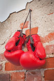 Boxing gloves on a nail Stock Photos