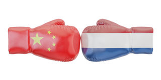 Boxing gloves with Netherlands and China flags. Governments. Conflict concept Royalty Free Stock Photography
