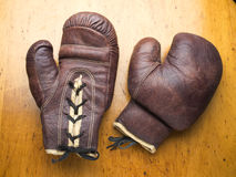 Boxing gloves. Old leather boxing gloves on table Stock Photos